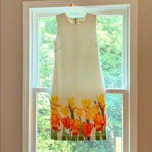 Calvin Klein dress with yellow and orange flowers.